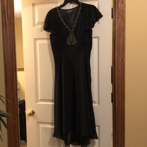 Timeless black dress with gold trim appliqué